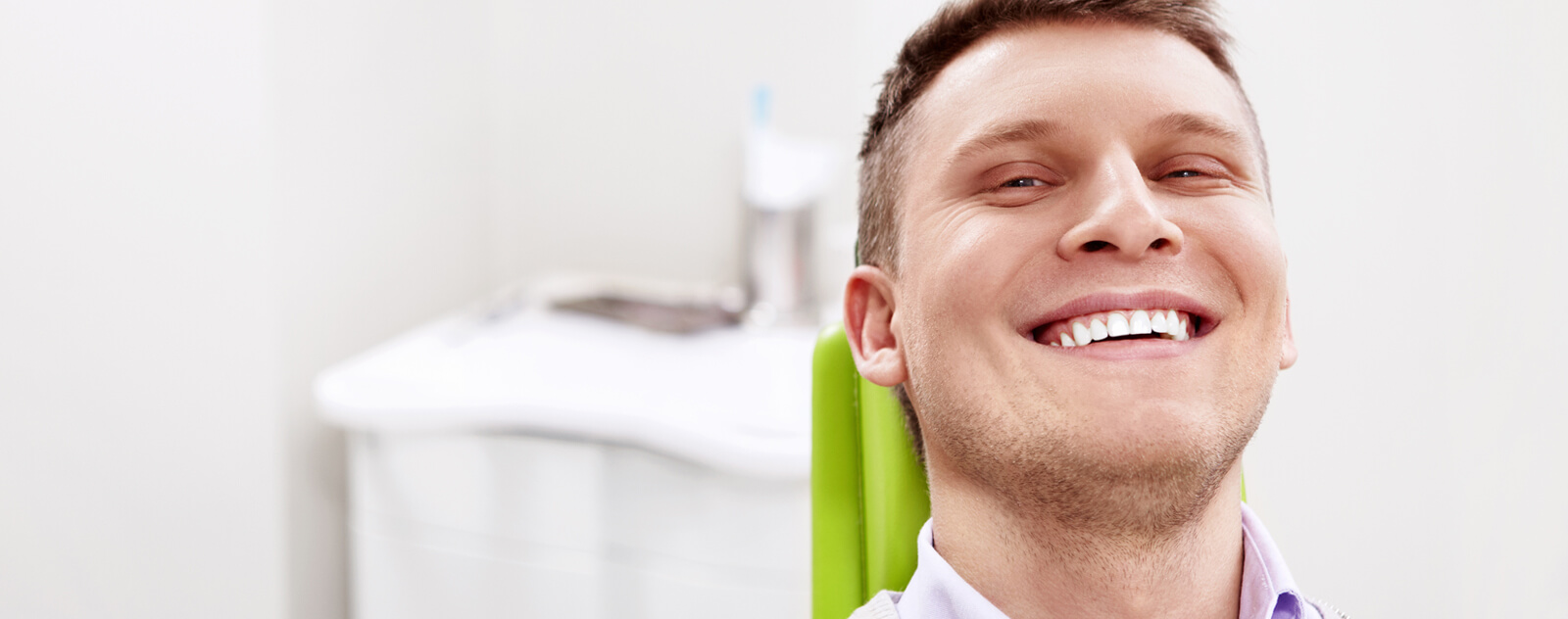 Man smiling happily in dental chair