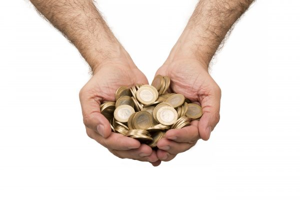 Hands holding gold coins